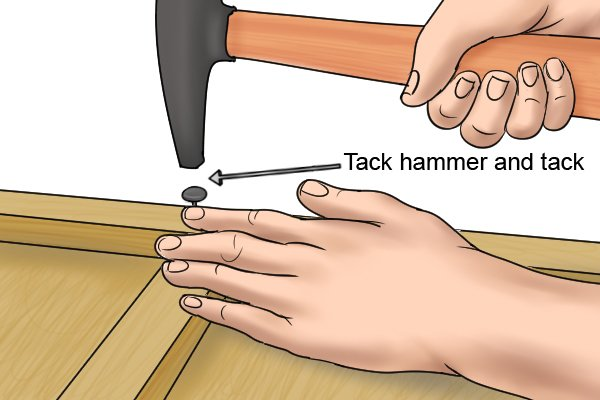 Tack hammer finishing off for a push pin