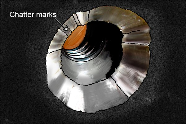 Chatter marks in a machined hole is seen as waves