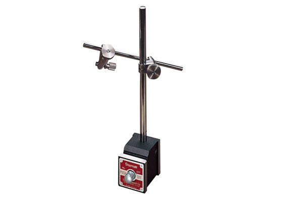 Moveable base which can be fixed to magnetic surfaces.