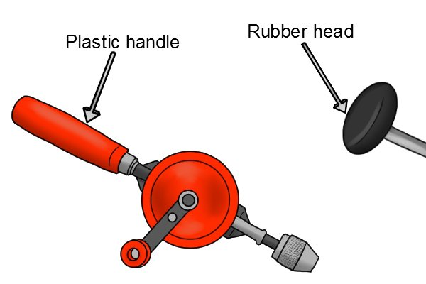 Plastic handle of a hand drill and the rubber head of a brace