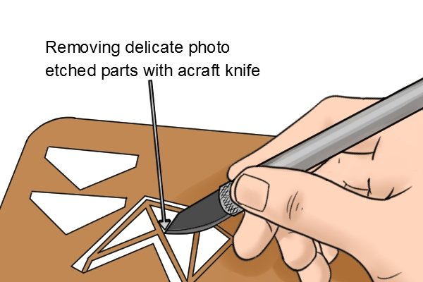 Removing small delicate photo etched parts from a sprue with a craft knife.