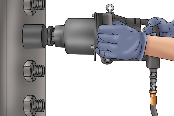 Using a hydraulic impact wrench.