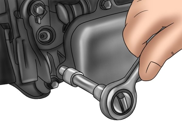 Socket and extension bar being used with a ratchet wrench to fit a spark plug in an engine