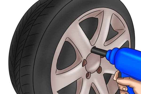 Using an impact wrench and impact socket to remove a cars wheel nuts