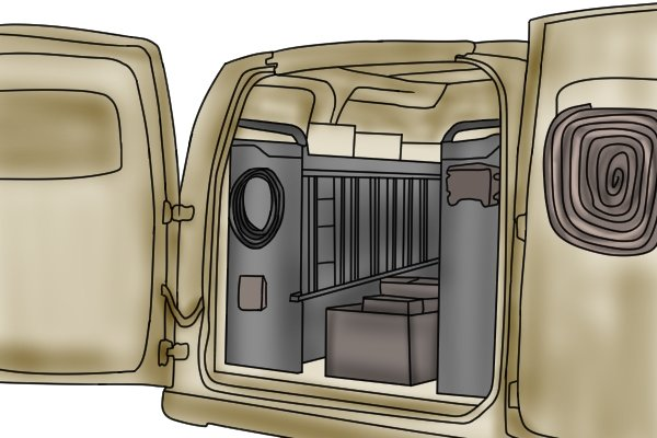 Van fitted out with racking and storage chest for transporting tools to a job site