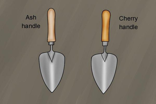 Cherry and ash wooden garden trowel handles on a planting garden trowel blade
