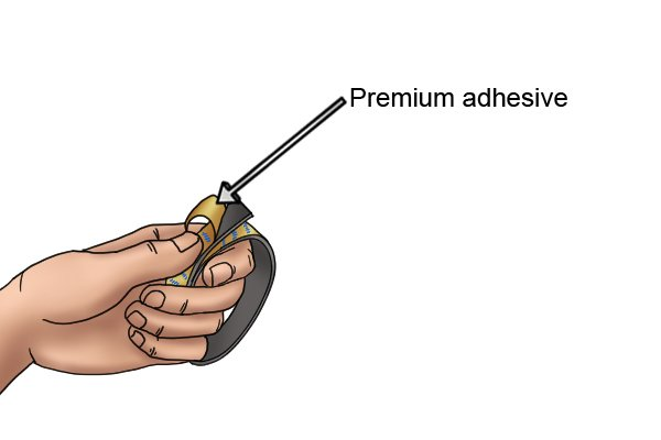 Premium adhesive on a piece of cut flexible magnetic tape