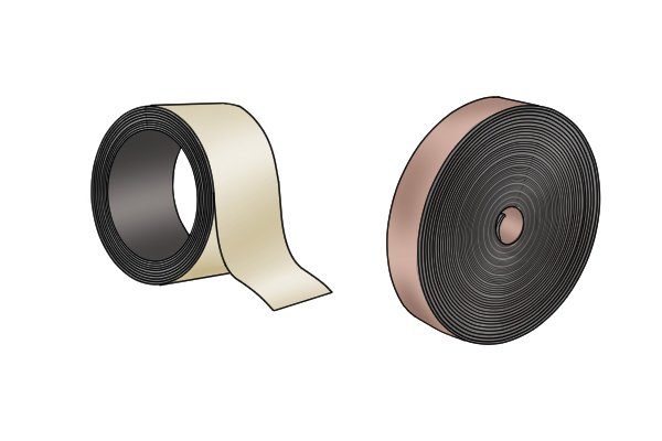 Two different size rolls of flexible magnetic tape