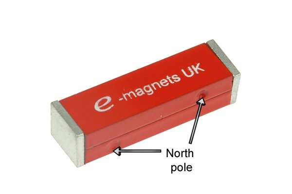 Notch indicating a north pole on two rectangle bar magnets joined together