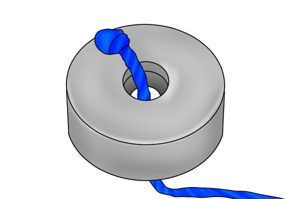 Ring magnetic disc with a piece of black rope through the centre to be used for fishing