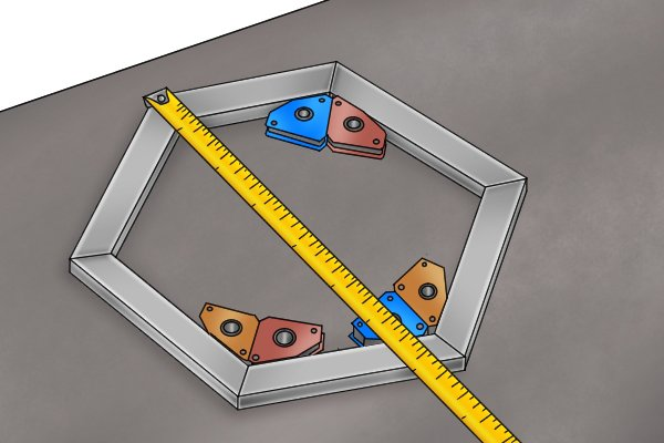 Layout work on a hexagon shaped steel structure with multiple magnetic square fixed multi angle weld clamp magnets