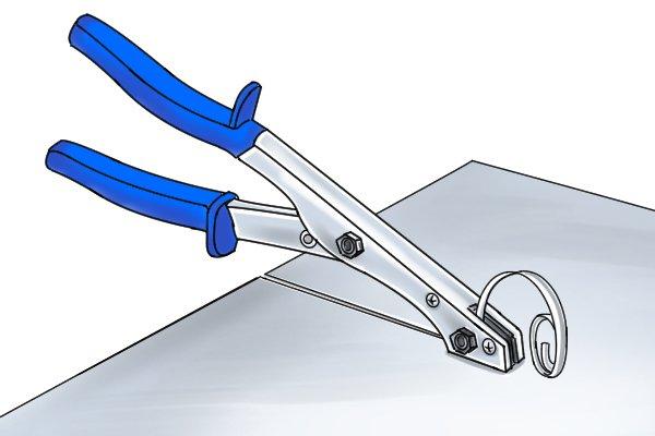 Nibbler shears cutting through sheet metal leaving no distortion