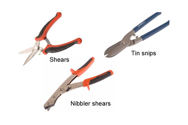 Tin snips, shears and nibbler shears all used to cut through sheet metal and other materials