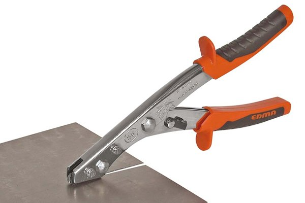 Nibbler shears cutting through sheet metal