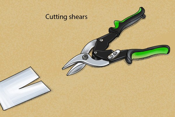 Cutting shears, slice through the material as opposed to nibbler shears which punch the blade upwards cutting out material