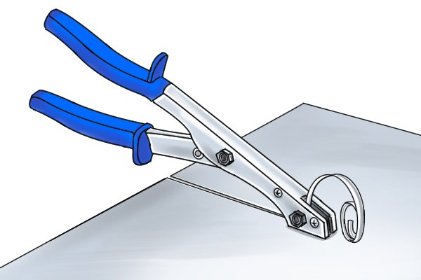 Nibbler shears cutting material and collecting excess cut out twisted upwards so that it does not get in the way