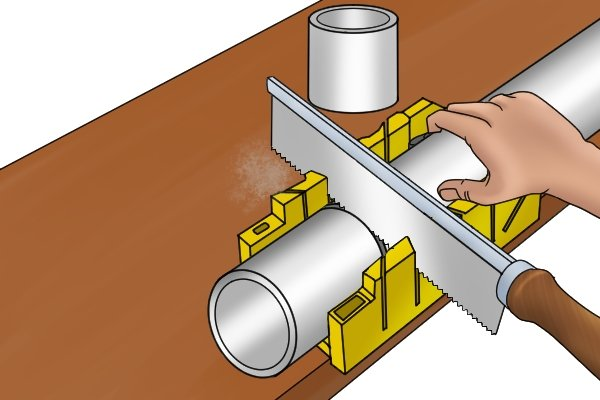 Wonkee Donkee Cutting PVC piping using a mitre box to ensure the cut is at 90° and therefore square