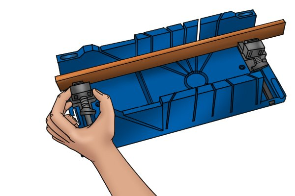 Wonkee Donkee Pinch together the sides of the workpiece clamp to release