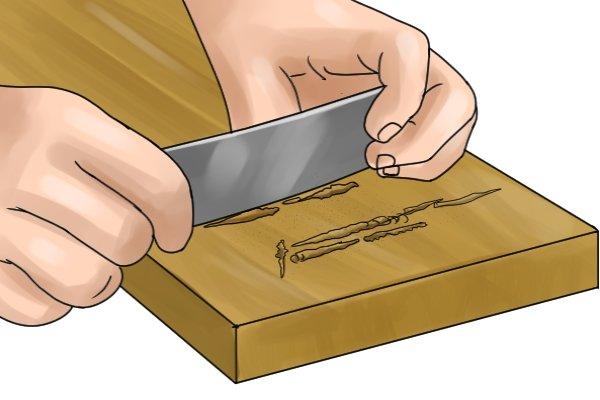 Cabinet scraper, scraping wood, woodwork, carpenter, DIYer, flat cabinet scraper.