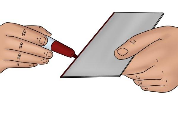 Cabinet scraper, card scraper, marker pen, smooth, edges, blade, diamond stone, tools, scraping, woodwork, carpenter, DIYer.