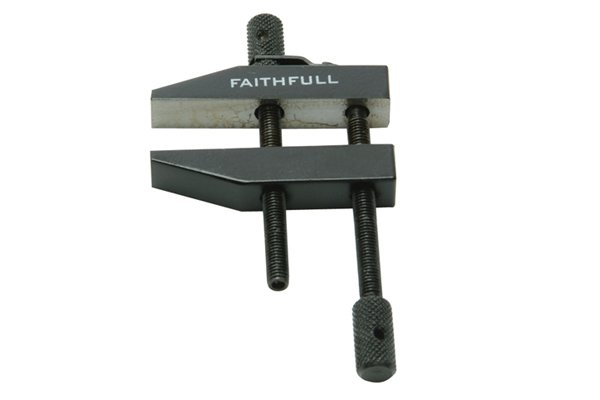 A clamp is a fastening device used to securely hold objects together, to avoid any movement or separation.