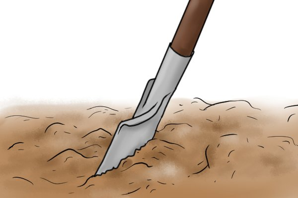 Using a spade with a straight edge to dig neat borders