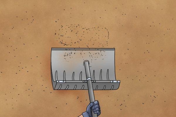 Shovelling grain