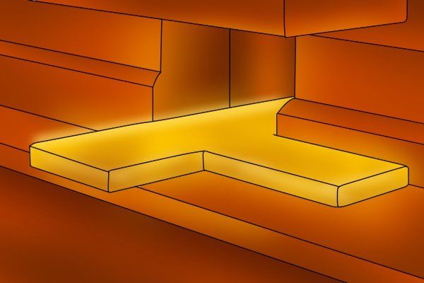 Planks of steel are heated to 1,100 degrees celsius then machine pressed into T-shaped pieces.