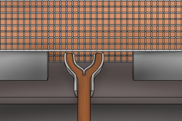 Each side of the slot spreads around the sides of the clamp, preparing the grip for its D-shape.