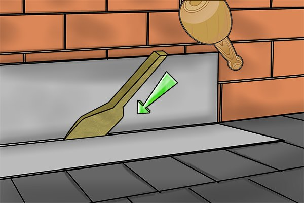Using the straight edge of a chase wedge to dress the flashing into position
