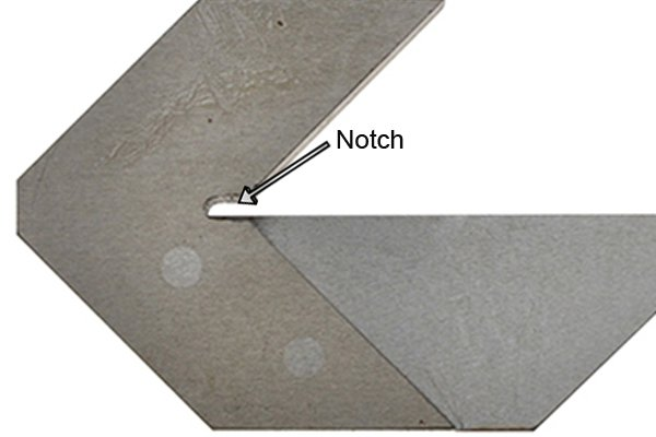 The notch in between the arms of the centre square provides a starting point from which the user can scribe.