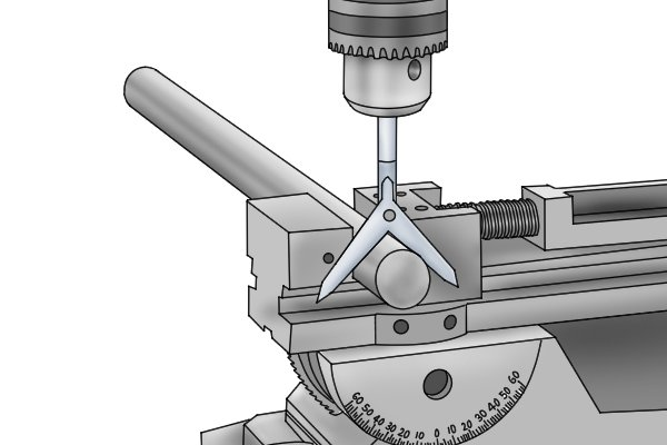 Whilst a centre square can be used to find the centre at the edge of a part, a round bar centre finder allows you to accurately find the centre of the middle of a part. To use, insert the shank of the tool into a drill press. When both the legs of the Y are resting on the bar stock and the two points line up, the drill press chuck is directly over the centre of the stock.