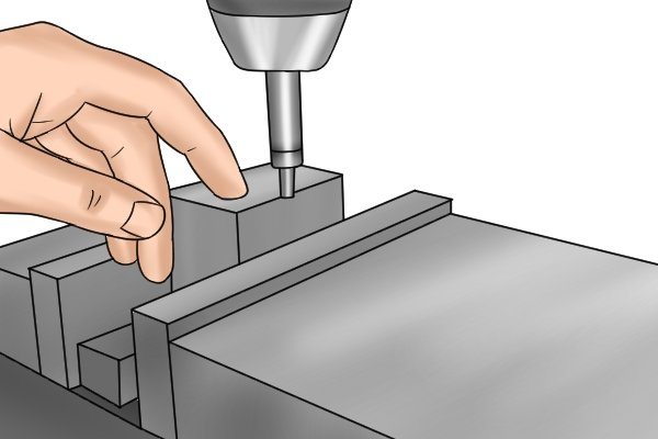 The edge finder (and spindle) will now be positioned directly over the centre of the edge of the part.