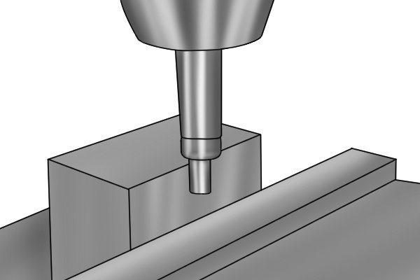 Step 6 Move the table of the machine longitudinally on the x axis so that the bottom of the edge finder just touches the part. As the edge finder approaches the edge of the part, it will start to wobble less. Eventually the tool will become centred and will run true (turn smoothly without wobbling).
