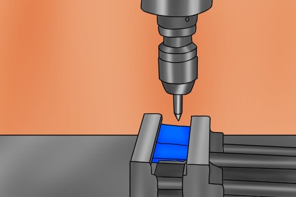 Step 1 Clamp the workpiece in a vise underneath the spindle of the machine. Step 2 Mount the centre in a collet or drill chuck and secure the tool to the spindle of your machine. The pointed tip of the tool will represent the centre of the spindle.