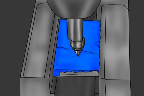 The end of the centre finder will probably be misaligned with the body, indicating that the mark is not directly below the spindle of the machine.