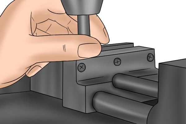 Step 5 To check the alignment of the centre finder, gently run your thumb and index finger up and down the sides of the tool. Make adjustments until you can no longer feel the transition between the body and the head of the tool. When the parts of the centre finder have aligned, you will have centred the spindle of the machine to within 0.03mm (0.001 inches).