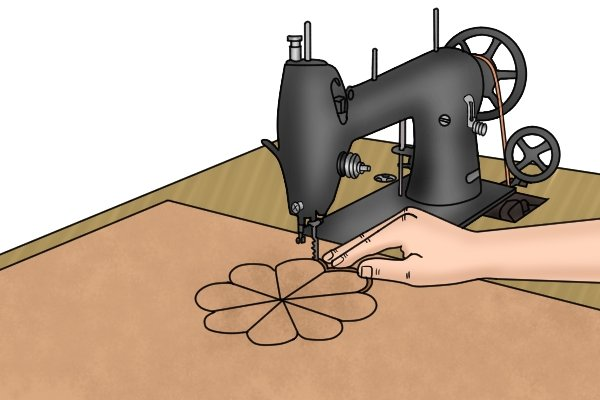 Sewing machine with woodcutting blade installed