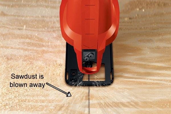 Jigsaw dust blower blowing away unwanted sawdust