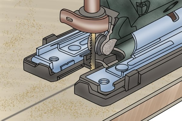 Jigsaw blade cutting on the upstroke with shoe flush against the workpiece