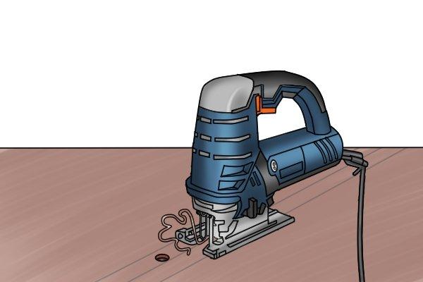 Metal cutting jigsaw, cutting metal with jigsaw, up-close image of jigsaw shoe, shoe of jigsaw