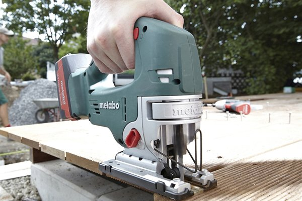 Using cordless jigsaw to cut decking, take your time when using a jigsaw