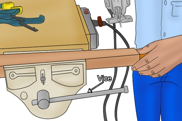 Holding wood in vice during jigsawing, using vice to hold workpiece before cutting it with a jigsaw, using a vice