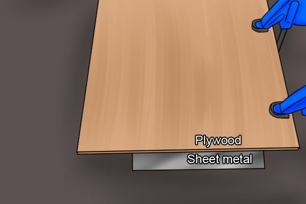 Plywood and sheet metal sandwich, cutting sheet metal, sandwiching thin sheet metal between two pieces of plywood