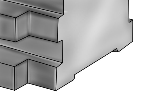 The base of the vee block has rectangular groove which fits into the t-slots of the table of the machine, and anchors the tool into position.