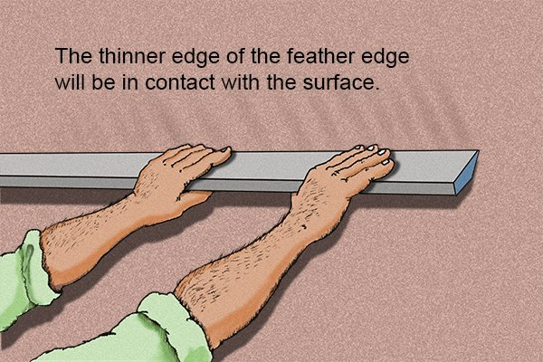 Hold feather edge tool in both hands
