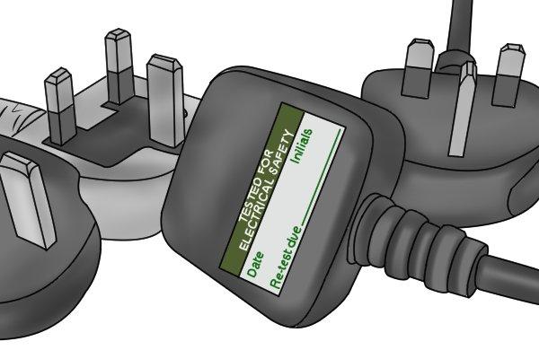 PAT testing label on plug