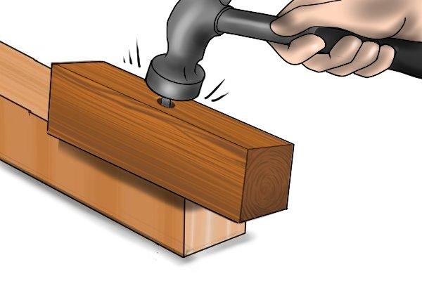 striking nail with hammer, pushing nail through from beneath board, nail, hammer, board