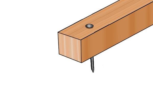 nail pushed up from under board, nail in board, push nail up from beneath, protruding nail