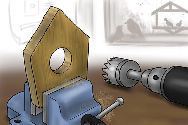 Hole saw cutting hole for birdhouse